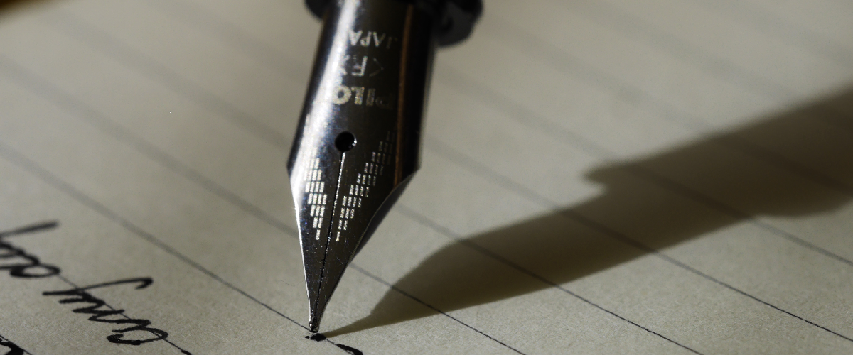 A ballpen pointing on the paper