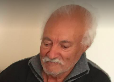 An old guy has white hair and mustache