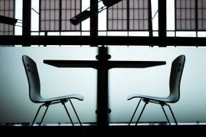 Two black chairs and a black table