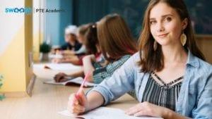 woman writing in class