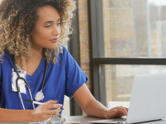 nurse on a laptop
