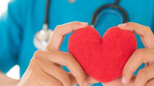 nurse holding heart