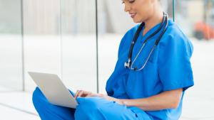 nurse reading on a laptop